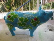 Sparschwein mit Glücksklee zur Geburt
