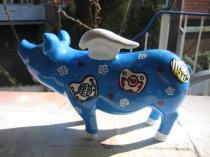 Sparschwein mit Schnuller zur Taufe