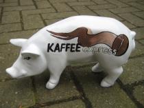 Sparschwein mit Kaffeebohne