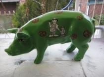 Sparschwein mit Brezeln und Bäcker