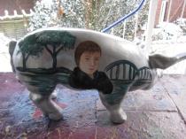 Sparschwein mit Portrait und Landschaft