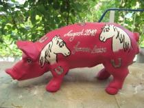 Sparschwein mit Pferdeköpfen